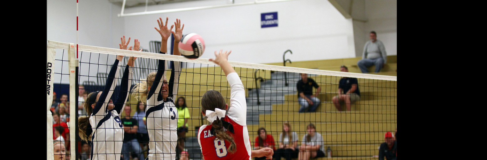 Des Moines Christian School Volleyball Players Blocking